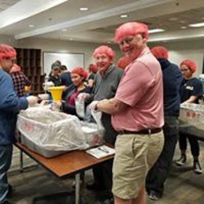 Rotarians and Interactors packaging 10,000 meals